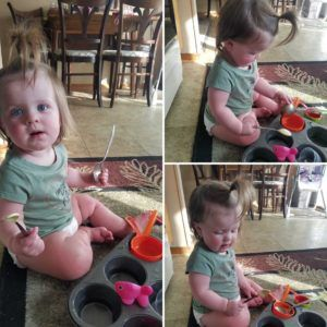 baby playing with a muffin tin