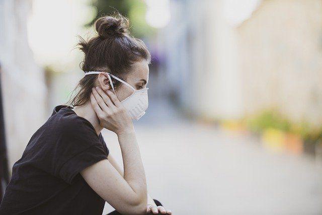 photo of woman wearing mask